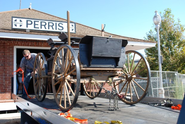 A wooden wagon that once belonged to city of Perris namesake Fred T. Perris is delivered on a tow truck to the old train depot in downtown Perris in 2008, as the depot was being converted into a historical museum. (Courtesy file photo)