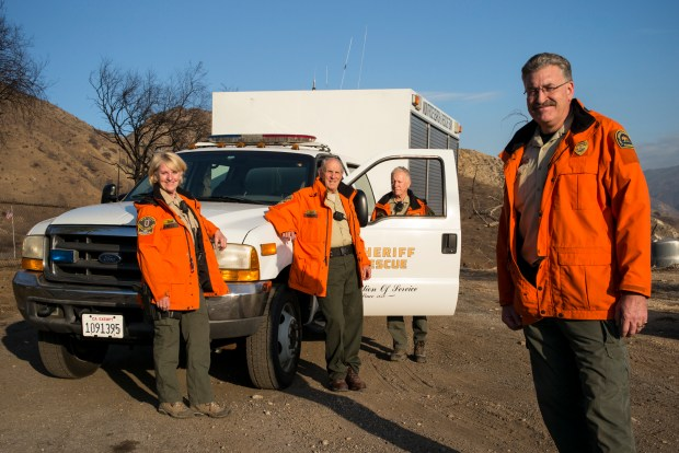From left: Lynda Daniels, J. Paneno, Fred Koegler and Steve Goldsworthy, all volunteers who are part of the Montrose Search and Rescue Team out of the Crescenta Valley Sheriff's Station. They were among those called to action in the Creek fire for evacuations and assistance. (Photo by David Crane/Los Angeles Daily News-SCNG)