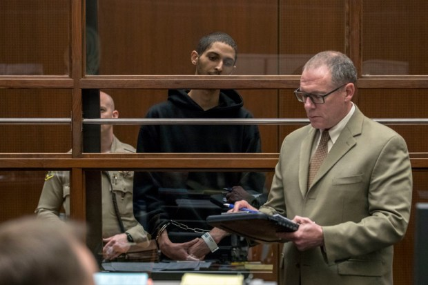 Tyler Barriss, center, stands near public defender Mearl Lottman as he appears for an extradition hearing at Los Angeles Superior Court on Wednesday, Jan. 3, 2018, in Los Angeles. Barriss, accused of making a hoax emergency call that led to the fatal police shooting of a Kansas man, told a judge Wednesday he would not fight efforts to send him to Wichita to face charges. (Irfan Khan /Los Angeles Times via AP, Pool)
