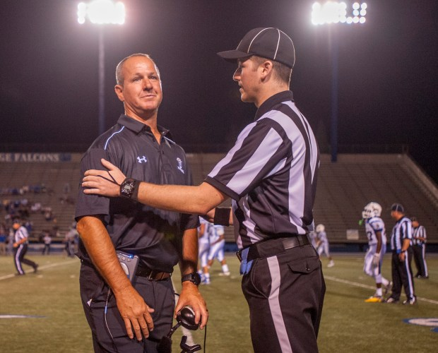 Scott Meyer, left, shown during a game in 2015, has resigned as the football coach at Servite. He was the team's coach for three seasons. (File photo: Michael Goulding, Orange County Register/SCNG)