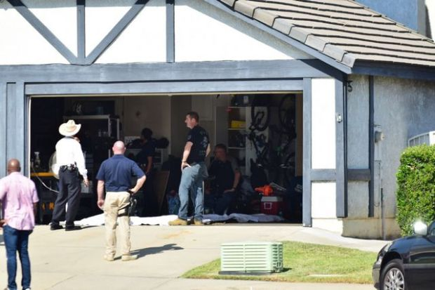 Los Angeles Police Department investigators raid the Rancho Cucamonga home of Officer Robert Cain on Thursday, June 22, 2017. (Photo by Doug Sanders/SCNG)
