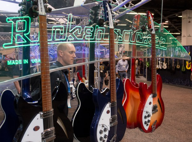 Buyer Derek Deyong looks at Rickenbacker guitars during the NAMM Show 2018 at the Anaheim Convention Center on Thursday, Jan. 25, 2018. (Photo by Keith Durflinger, Orange County Register/SCNG)