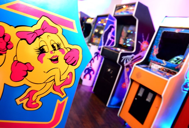 Pasadena-based Neon Retro Arcade is about to open a second location in Northridge. The new arcade atÊ8943 Reseda Blvd. will officially open its doors on Jan. 26 and owners Mark Guenther and Mia Mazadiego figure it will resonate with gamers there just as much as it has in Pasadena.  (Photo by Dean Musgrove, Los Angeles Daily News/SCNG)