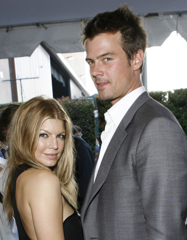 ORG XMIT: NY115 ** FILE ** In this Sunday, June 3, 2007 picture, Fergie and Josh Duhamel arrive at the MTV Movie Awards in Los Angeles, Calif. Fergie's manager William Derella said by e-mail that the singer-actress, whose real name is Stacy Ferguson, and the 36-year-old actor were married Saturday, Jan. 10, 2008 at the Church Estates Vineyards in Malibu. (AP Photo/Kevork Djansezian)