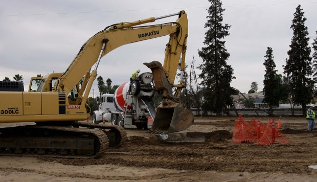 A construction crew works on a senior housing complex in Perris in January 2011. Amid a building boom, the city's population grew by more than 25 percent between fiscal year 2011 and 2012.(File photo by Frank Bellino, The Press-Enterprise/SCNG)