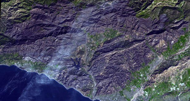 Dec. 27, 2017 image provided by NASA/JPL-Caltech, taken from the NASA Terra satellite, posted by the Jet Propulsion Laboratory of the California Institute of Technology Friday, Jan. 5, 2018, shows the wide area of destruction of the Thomas fire, the largest wildfire in California's recorded history. (NASA/Jet Propulsion Laboratory/CalTech via AP)