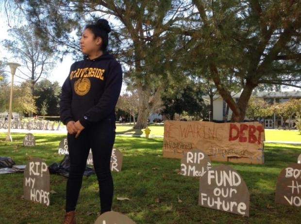 UCR student Erika Perez stands among an installation on campus meant to protest a 2.5 percent tuition hike approved by the UC Regents on Thursday.
