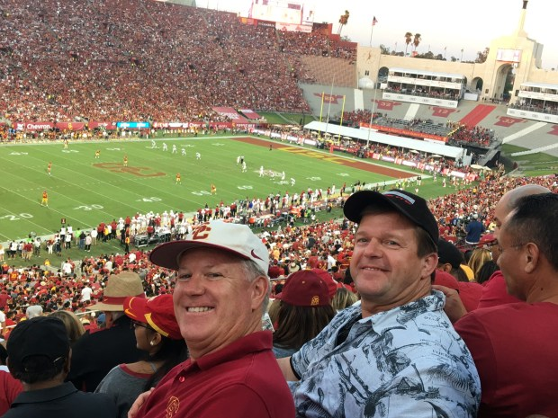 Jeff Adams, left, and brother Brandon Blaylock attend a USC football game together last year. The pari had unwittingly attended USC together in the early 1980s, but never knew it until now.