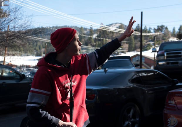 Tim Hughes, 19, of Victorville looks towards Big Bear's Mountain Vista Resort where fugitive Christopher Corner hid in 2013. Photographed on Sunday, Feb. 4. (Photo by Cindy Yamanaka, Orange County Register/SCNG)