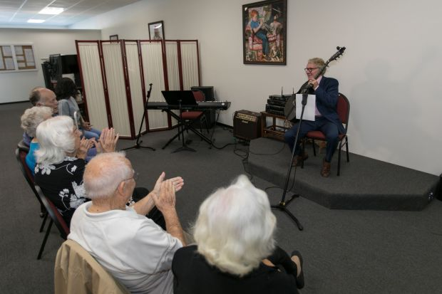 Patrons of Your Home Care in Laguna Woods applaud a guitarist performing live at the daycare. Courtesy photo)