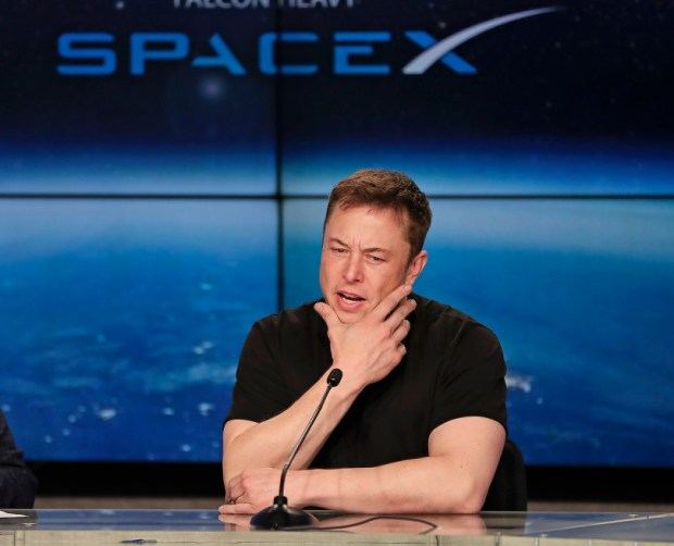 Elon Musk, founder, CEO of SpaceX and Tesla, and lead designer of SpaceX, speaks at a news conference after the Falcon 9 SpaceX heavy rocket launched successfully from the Kennedy Space Center in Cape Canaveral, Fla., Tuesday, Feb. 6, 2018. (AP Photo/John Raoux)
