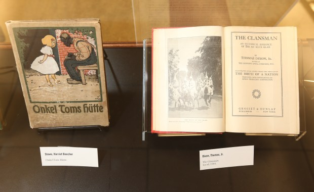 """Onkel Toms Hutte"", left, and ""The Clansman"" on display at the ""Footsteps to You: Chattel Slavery"" exhibition at UCR's Rivera Library on Friday, Feb. 9, 2018, in Riverside, Calif.. (Stan Lim, The Press-Enterprise/SCNG)"