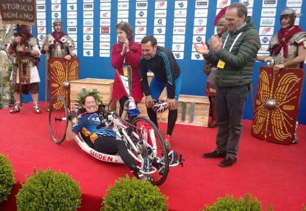 In 2014, San Clemente's Beth Sanden was pictured being honored on the podium at the Rome Marathon in Italy. (Courtesy of Beth Sanden)