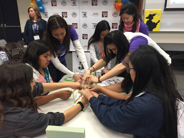 Middle and high school students used plastic straws and tape to build bridges at Girls Engineering Day, held at Anaheim's South Junior High School on Saturday, Feb. 24. /Photo by Alicia Robinson, The Orange County Register/SCNG