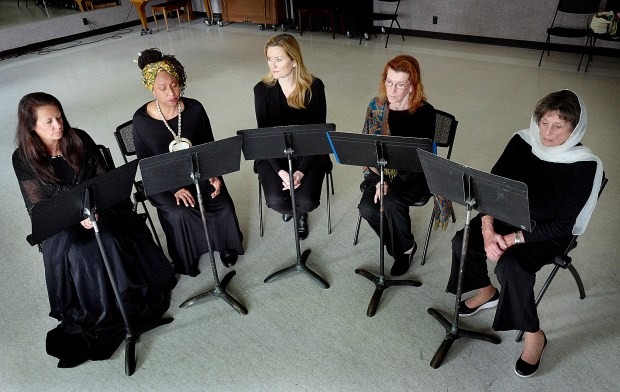"""Resident CeCe Sloan is produced and directed the play """"Seven"""" in 2017 in Laguna Woods Village to celebrate International Women's Day. Five of the seven performers pictured, Andrea Riggs, (l) Victoria Burnett, Carrie Pohlhammer, Carol Shallin and Shelley Rones represent women from Russia, Pakistan, Nigeria, Northern Ireland, Afghanistan, Guatemala, and Cambodia. File photo by Michael Fernandez, Contributing Photographer"""