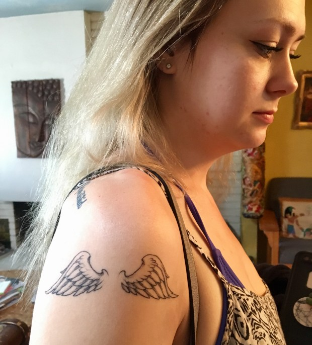 Curly Girl's new wings, inked by King Ruck of Black Spade tattoo in Las Vegas. Frumpy Mom, her mom, and brother Cheetah Boy got matching tattoos in honor of his 21st birthday. Photo by Marla Jo Fisher, Feb. 2018.