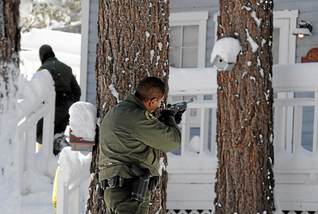 (Will Lester/Staff Photographer) San Bernardino County Sheriff deputies continue to search door-to-door along Willow Avenue in Big Bear for ex-LAPD fugitive Christopher Jordan Dorner Saturday February 9, 2013. Search conditions improved Saturday as skies cleared in the area after a heavy winter storm dropped over a foot of snow in the mountain community Friday.