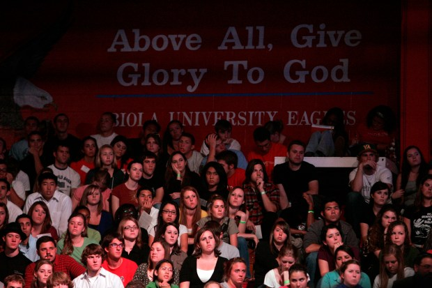 Students watch Christopher Hitchens, columnist and author, debate William Lane Craig, a Christian Apologetics professor at Biola, on Does God Exist? at Biola University's Chase Gymnasium in La Mirada Saturday night, April 4, 2009. (SGVN/Staff Photo by Sarah Reingewirtz/SVCITY)