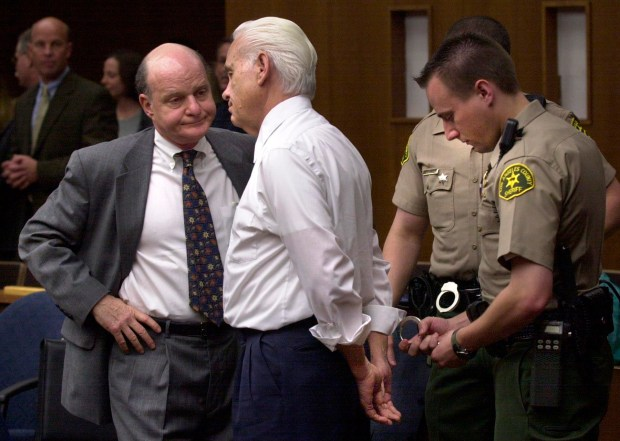 William Terry Bradford, center is hadcuffed and taken into custody after being found guilty in 2002 of murdering his wife in 1998 in Torrance. His attorney is at left. Photo by Brad Graverson 4-10-02