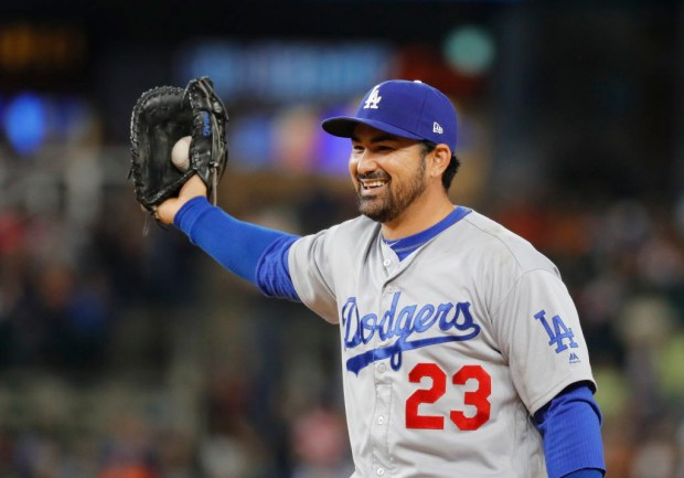 FILE - In this Aug. 18, 2017, file photo, Los Angeles Dodgers first baseman Adrian Gonzalez smiles after catching a Detroit Tigers' Ian Kinsler line drive in the eighth inning of a baseball game, in Detroit. Free agent first baseman Adrian Gonzalez and the New York Mets have finalized a one-year contract for the $545,000 major league minimum. The 35-year-old batted .242 for the Los Angeles Dodgers last season, when he was limited to 71 games because of a herniated disk in his back. A five--time All-Star, Gonzalez has a .288 career average with 311 home runs in 14 major league seasons.(AP Photo/Paul Sancya, File)