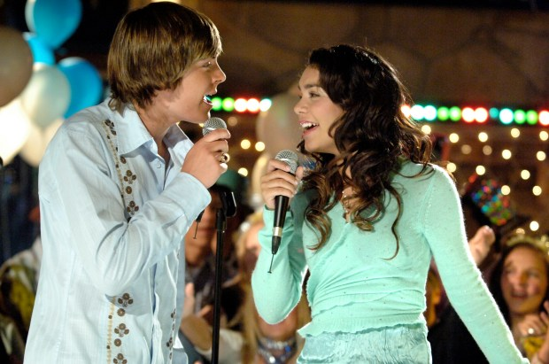 """High School Musical"" tells the story of two high school students - Troy (Zac Efron), a popular basketball player and Gabriella (Vanessa Anne Hudgens), a shy, brainy newcomer - who share a secret passion for singing. (DISNEY CHANNEL/FRED HAYES)"