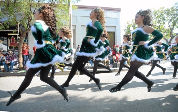 Members of the Irish Dimensions dance group perform during the 38th Annual Upland Christmas Parade & Holiday Faire in downtown Upland, Saturday, December 6, 2014.  (Photo by John Valenzuela/ Inland Valley Daily Bulletin)