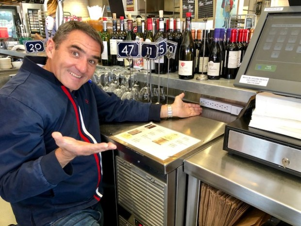 Laurent Vrignaud of Moulin in Newport Beach is happy to be rid of all the food delivery tablets clogging up his takeout counter. (Nancy Luna, Orange County Register/SCNG)
