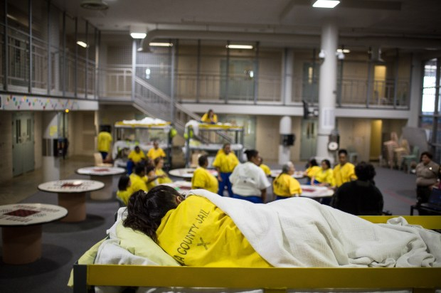 Non-serious offenders sleep in bunks outside cells as others take a mandated class in the Women's Jail in Lynwood on December 18, 2017. The county wants to move the jail to the now vacant Mira Loma Detention Center in Lancaster. (Photo by Sarah Reingewirtz, Los Angeles Daily News/SCNG)