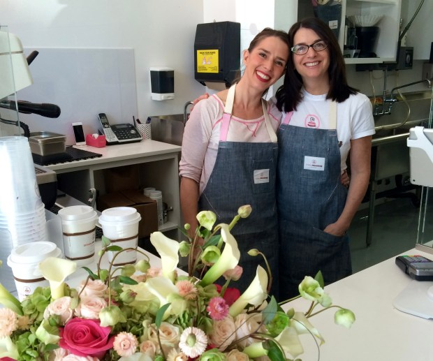 Lisa Olin and her business partner, executive pastry chef Elizabeth Belkin, at the opening of Cake Monkey Bakery in Los Angeles. (Courtesy photo)