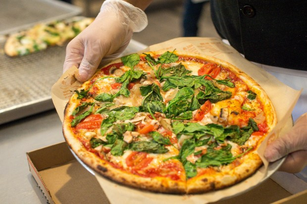 A Pasadena-based Blaze Fast-FireÕd Pizza is boxed for a take-out order on Wednesday, Feb. 28, 2018. The company is adding 400 locations across the U.S., Canada, the Middle East and North Africa and continues to maintain its target of 1,000 restaurants within four to seven years. (Photo by Sarah Reingewirtz, Pasadena Star-News/SCNG)