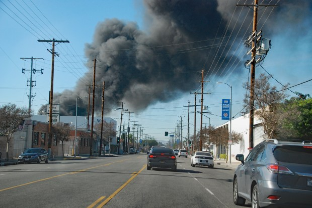 A huge column of heavy smoke rose into the sky as recycling material burned Saturday. The fire was in the 13300 block of Saticoy Street in Sun Valley.Photo by Michael Meadows