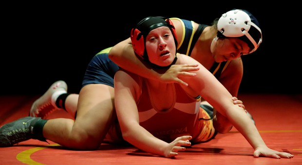 Carter's Anna Castro controls Corona's Abbi Turner in their 160lbs. Championship bout during the Queen of the Hill girls wrestling tournament at Santiago High School Saturday in Corona, CA. December 30, 2017. (TERRY PIERSON,THE PRESS-ENTERPRISE/SCNG)
