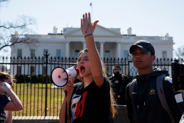 Sofia Hidalgo, 15, of Glenmont, Md., chants during a student protest for gun control legislation in front of the White House, Wednesday, Feb. 21, 2018, in Washington. (AP Photo/Evan Vucci)