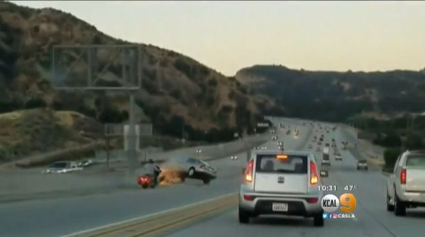 Andrew Flanigan, 45, of Arleta, faces several felony charges in connection with this June 21, 2017 road-rage incident that was caught on video on the 14 Freeway near Newhall Avenue. The motorcyclist is seen kicking this Nissan, which then swerved out of control and struck an SUV, which overturned, injuring the motorist inside. Flanigan was arrested Tuesday, March 27, 2018. (Image from KCAL9 video)