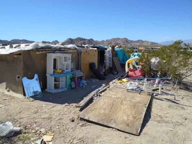 Three children were found living inside a box on a property in the 7000 block of Sun Fair Road in Joshua Tree. Their parents, Mona Kirk, 51, and Daniel Panico, 73, were taken into custody by San Bernardino County sheriff's deputies Wednesday. (Courtesy photo)