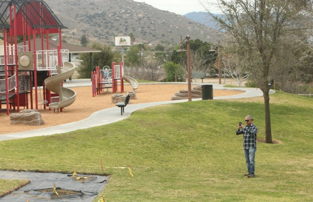 Arlen Verdehyou, of Norco, takes photos at the site of a garden that will be planted in the shape of a heart in honor of his late wife, Bennetta Betbadal, at Pikes Peak Park in Norco. Bennetta was killed in the Dec. 2, 2015 terrorist attack in San Bernardino.(Stan Lim, The Press-Enterprise/SCNG)
