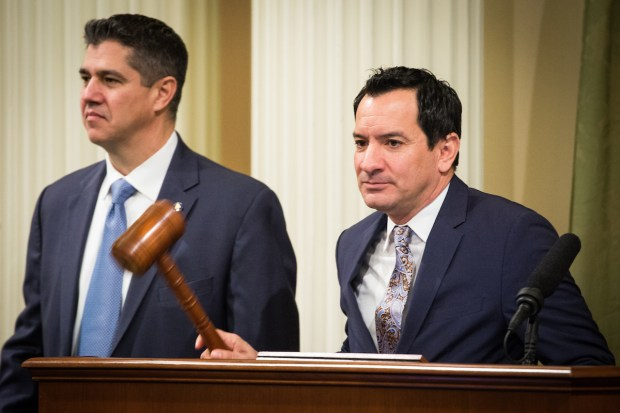 Assembly Speaker Anthony Rendon, right, calls the assembly to order before the State of the State address at the State Capitol in Sacramento, California, January 25, 2018.
