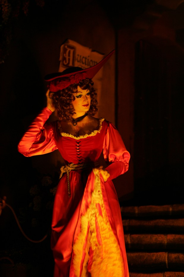 The Redhead in the auction scene of Pirates of the Caribbean will be recast as a pirate when the attraction reopens later this year. (File photo by: Bruce Chambers, Orange County Register/SCNG)