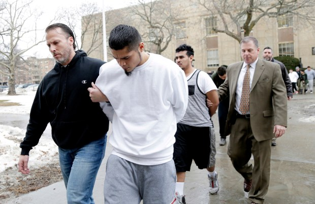 Suspected members of the MS-13 gang are escorted to their arraignment in Mineola, N.Y., on Jan. 11. The gang has been especially active in a few cities along the East Coast. (AP file photo/Seth Wenig)
