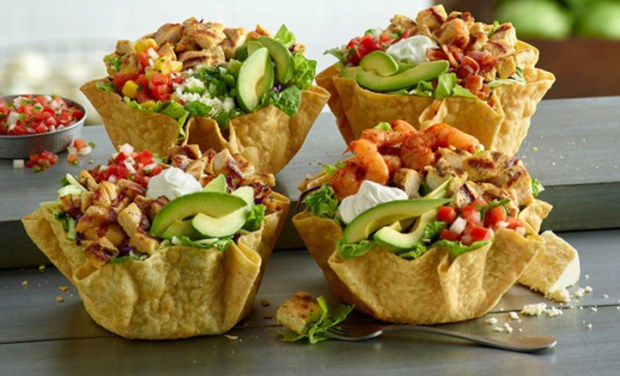 """EPL is bringing back four """"best-selling"""" tostadas for a limited time. They include the chicken and shrimp tostada, seen here, with avocado, beans, sour cream, rice, cheese, pico de gallo;the double chicken (chicken, avocado, beans, sour cream, rice, cheese, pico de gallo);avocado bacon (chicken, avocado, bacon, beans, sour cream, rice, cheese, pico de gallo);avocado mango chicken (chicken, avocado, mango salsa, beans, rice, cotija, cilantro). (Photo courtesy of EPL)"""