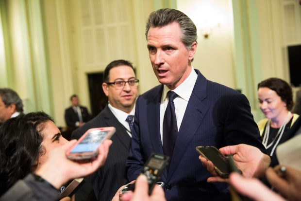 Lt. Gov. Gavin Newsom talks to reporters. Photo by Max Whittaker for CALmatters
