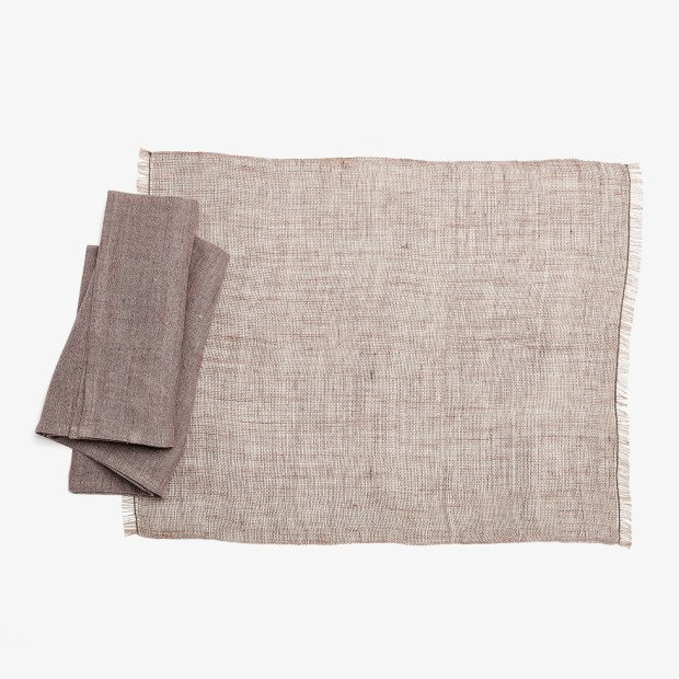 Latvian textile artist Laima Kaugure and her company, Studio Natural, use traditional weaving techniques to construct pieces such as this tinita linen placemat and ieva krakel linen napkin, both available through abchome.com. (Photo by ABC Home)