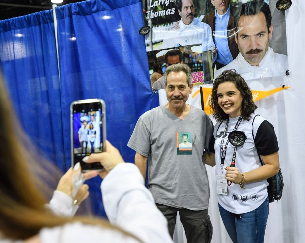 Tiffany Smith poses with actor Larry Thomas, famous for being the Soup Nazi on Seinfeld, at a signature booth during WonderCon in Anaheim on Friday, Mar 23, 2018. (Photo by Jeff Gritchen, Orange County Register/SCNG)