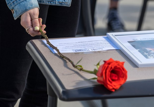 A student touches a flower as it lays on one of the 17 empty desks, one for each victim, at San Juan Hills High School in San Juan Capistrano as students gather in their upper quad in tribute to Parkland shooting victims during the morning walkout on Wednesday morning, March 14, 2018. (File Photo by Mark Rightmire, Orange County Register/SCNG)