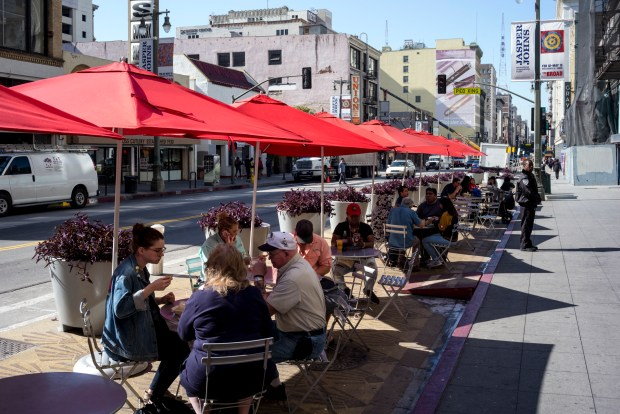 Broadway street in Los Angeles in front of Grand Central Market with street seating. (Photo by David Crane, Los Angeles Daily News/SCNG)