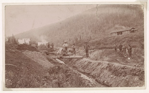 Gold miners pose near their camp on a hillside in El Dorado, California circa 1853. (Library of Congress)