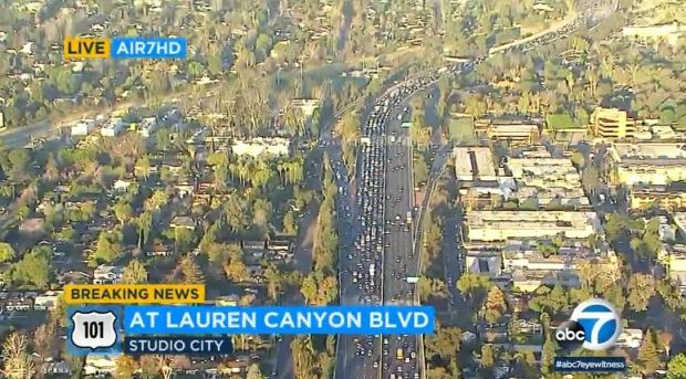 A shot from the ABC7 helicopter shows the traffic backup early Friday, March 9, 2018, from a crash that killed a bicyclist who was either walking or riding on the eastbound 101 Freeway near Laurel Canyon Boulevard in Studio City. (Image from ABC7 video)