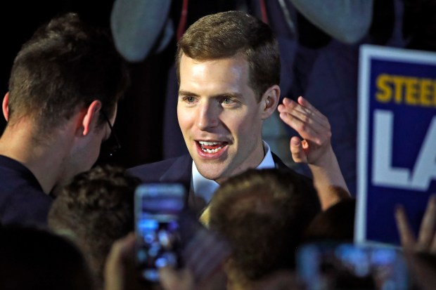Conor Lamb, the Democratic candidate for the March 13 special election in Pennsylvania's 18th Congressional District, center, celebrates with his supporters at his election night party in Canonsburg, Pa., early Wednesday, March 14, 2018. (AP Photo/Gene J. Puskar)