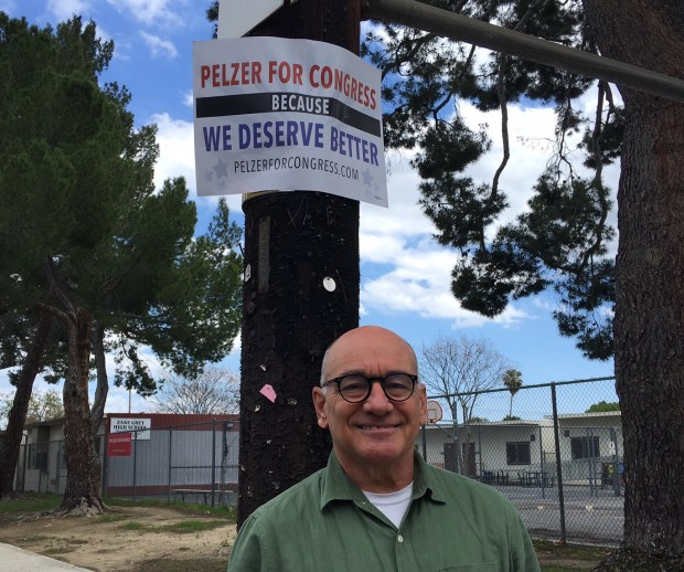Jon Pelzer, a Democrat, one of four candidates running against Rep. Brad Sherman, D-Sherman Oaks, in the June 5 primary, poses with a campaign sign in Reseda on Sunday, March 25, 2018. (Photo by Kevin Modesti/Daily News/SCNG)