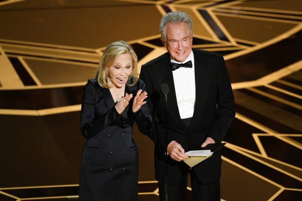 HOLLYWOOD, CA - MARCH 04: Actors Faye Dunaway (L) and Warren Beatty speak onstage during the 90th Annual Academy Awards at the Dolby Theatre at Hollywood & Highland Center on March 4, 2018 in Hollywood, California. (Photo by Kevin Winter/Getty Images)